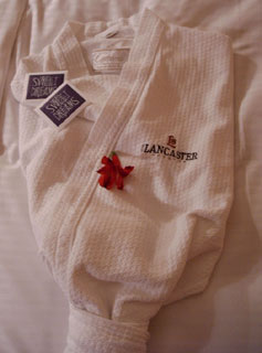 Turndown service, with chocolate and robe ready at the Lancaster Hotel