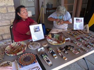 Local Native Americans explaining the process of making Hopi baskets and dolls