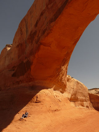Rhonda sitting at Wilson Arch